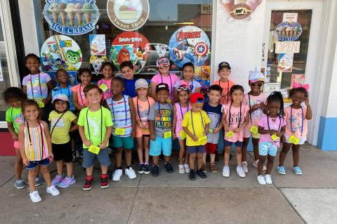 ABOVE: I scream - you scream - we all scream - for ice cream! After a week of learning about how ice cream is made and doing lots of ice cream crafts, Creative Minds Childcare took a walk with the older children downtown to Martin's Sweet Shop to enjoy Blue Bell Ice Cream. Courtesy photo