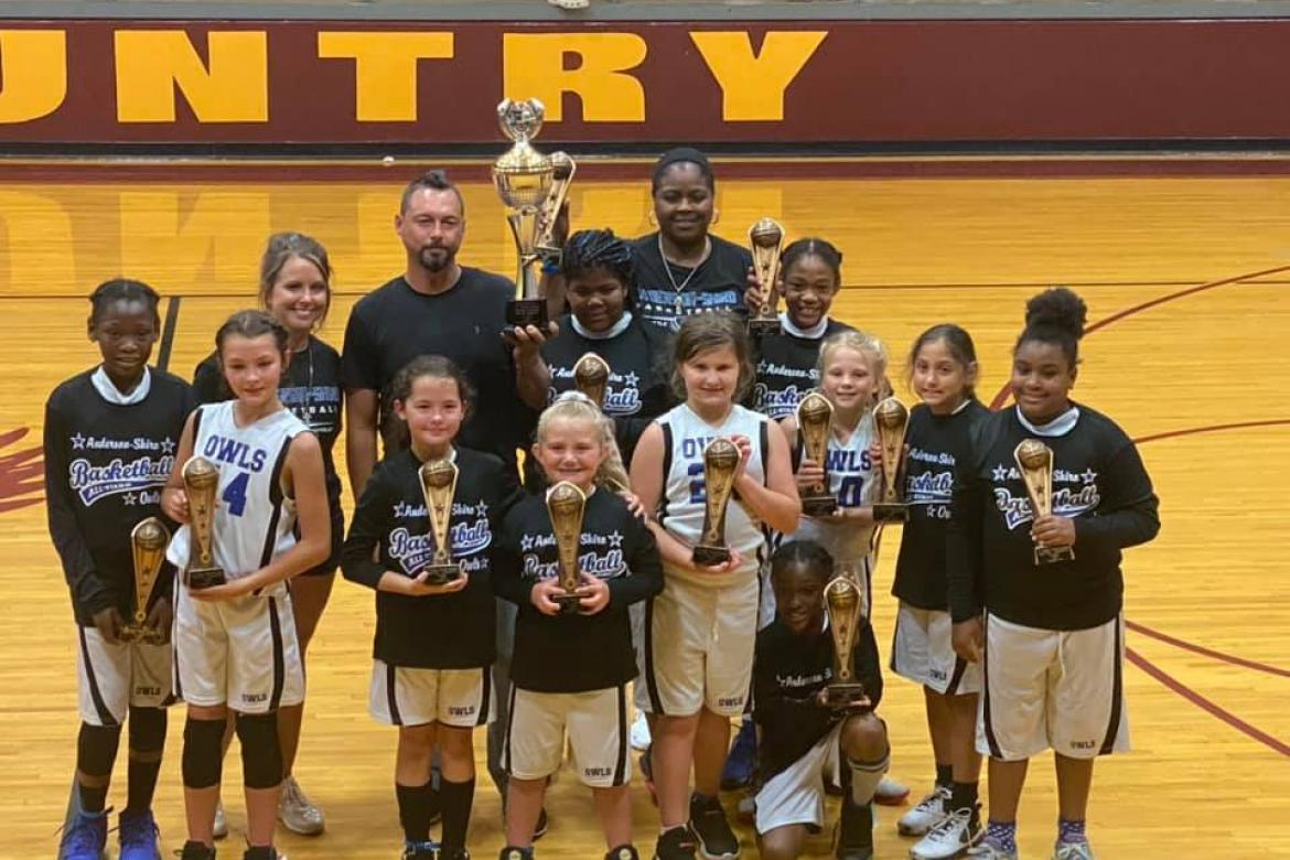 Courtesy photo The Anderson-Shiro Junior Girls won the 2020-2021 Little Dribblers Continental Division National Championship with a 34-17 win over Evadale. Pictured are Kayleigh Wharton (kneeling). Front row left to right: Zaria Whorton, Harper Korenek, Jaylie Hurst, Allie Walkoviak, Catelyn Turner, Bristol Cosby, Kelli Belinowski, and Mila Foy. Back row:  Julie Walkoviak (coach), Joe Hurst (coach), Bre Adair, Atina Adair (coach) and Skye Alexander.